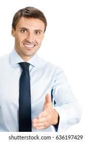 Happy smiling young business man giving hand for handshake, isolated over white background. Success in business, job and education concept shot.
