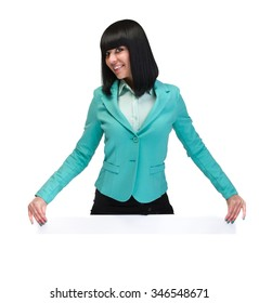 Happy smiling young business woman showing blank signboard, isolated on white