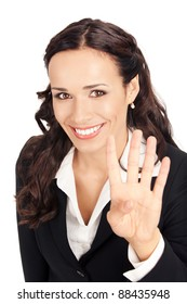 Happy smiling young business woman showing four fingers, isolated on white background