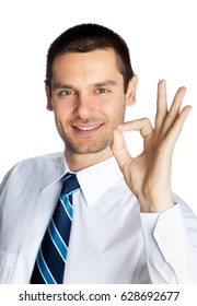 Happy smiling young businessman with okay gesture, isolated on white background. Success in business, job and education concept shot.