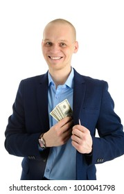 Happy smiling young Businessman putting money in his suit pocket, isolated on white.