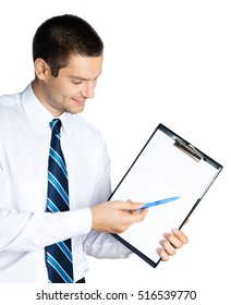 Happy smiling young businessman showing blank clipboard, isolated against white background. Success in business, job and education concept studio shot.