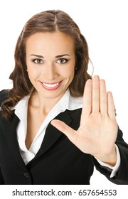 Happy smiling young businesswoman showing stop gesture, isolated over white background. Business concept.