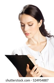 Happy smiling young businesswoman writing on clipboard, isolated on white background