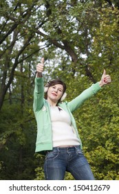 Happy smiling young girl with okay gesture