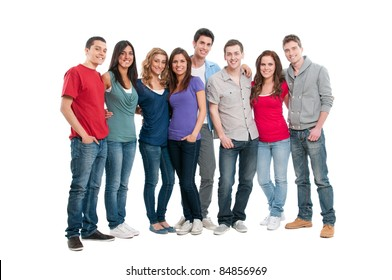 Happy smiling young group of friends standing together isolated on white background
