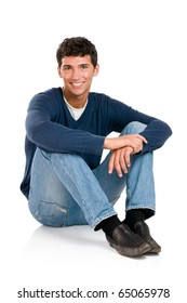 Happy smiling young man sitting on floor isolated on white background