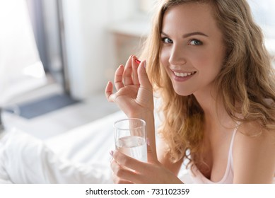 Happy smiling young woman need treatment