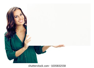 Happy smiling young woman showing blank signboard or copyspace for advertise, slogan or text, isolated against white background