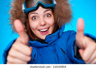 happy snowboarder smiling and showing thumbs up