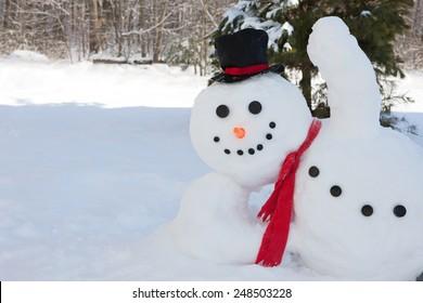 Happy snowman waving his hand