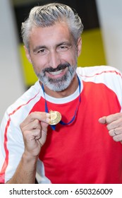 happy sport man with medal