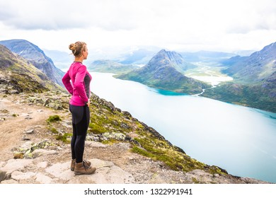 Happy sport woman hiking in Bassegen. Norway.