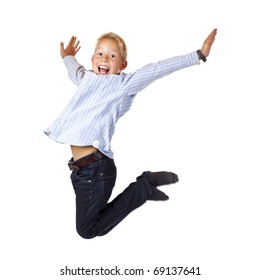 Happy sportive boy jumps with spread arms in the air. Isolated on white background.