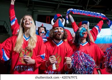 Happy sports fans in stadium
