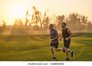 The happy sportsmen running in the beautiful park