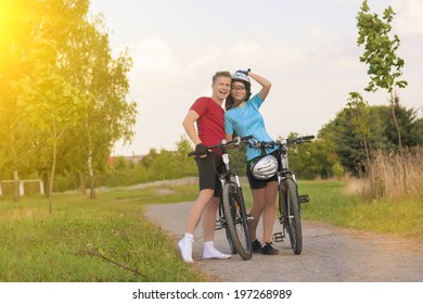 Happy Sporty Biker Couple in Sunny Day Outdoors. Horizontal Composition