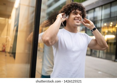 Happy sporty fit man running to stay healthy outdoor