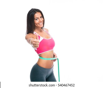 Happy sporty woman with measuring tape and showing thumb up sign isolated on a white background