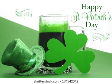 Happy St Patrick's Day green beer in large glass stein with shamrocks and leprechaun hat and sample text greeting, on green and white background.