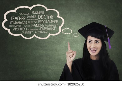 Happy student in graduation cap with her future career