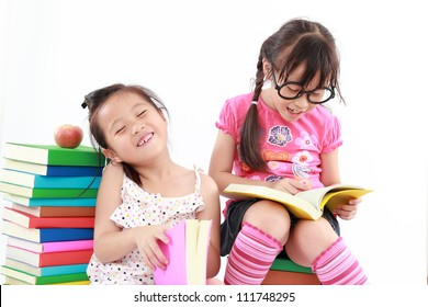 happy student little girl reading the book