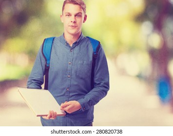 happy student man with a notebook