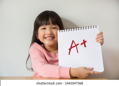 Happy student showing  very good grade
