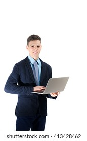 Happy student teenager working on laptop isolated in white background