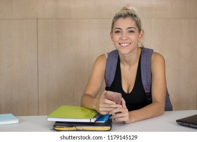 Happy student using a mobile phone