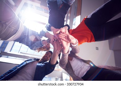 happy students celebrate, friends group together at school,  young people raise hands, stack and get in circle  formation together