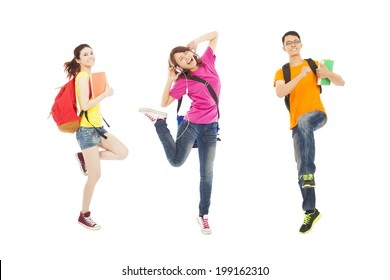 happy students listening music and jumping with books