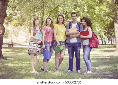 Happy students in park, group of people