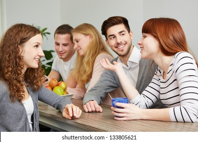 Happy students taking a coffee break in break room