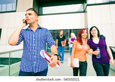Happy Students Walking Out Of College