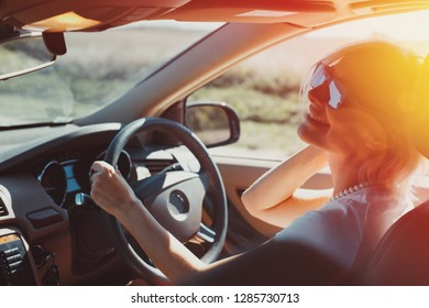 Happy successful adult woman enjoys driving in a road adventure. Holiday vacation travel concept