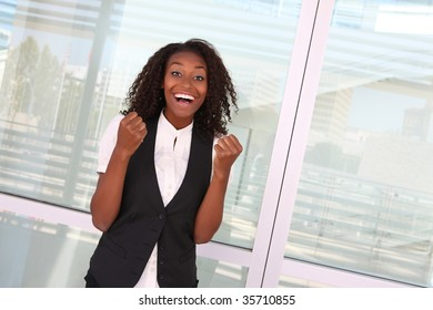 Happy successful African American business woman at company celebrating