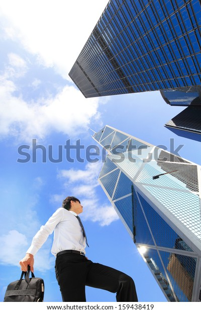 happy successful business man outdoors Next to Office Buildings with cityscape and sky, hong kong, asia, , asian people