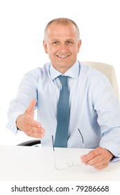 Happy successful businessman giving handshake close deal isolated portrait