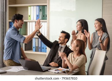 happy successful businesspeople, man and woman, after signing agreement, achievement and appreciation concept, selective focus