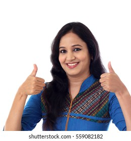 Happy successful Indian woman with thumbs up sign