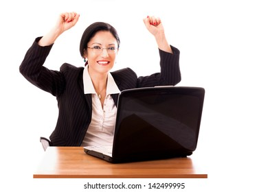 Happy successful lady manager at her desktop celebrating an achievement.