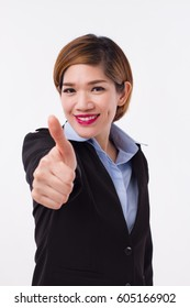 happy, successful, smiling businesswoman giving thumb up, approval, good, ok hand gesture