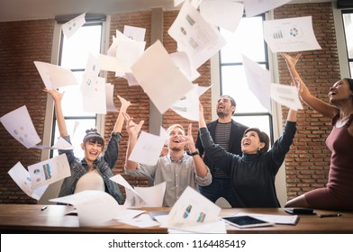 Happy Successful teamwork throwing work year planning paper in the Air. Business Corporate People Working Concept.