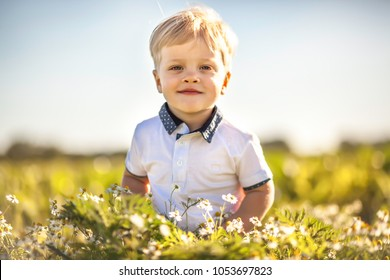 Happy summer boy outdoor in sunny day
