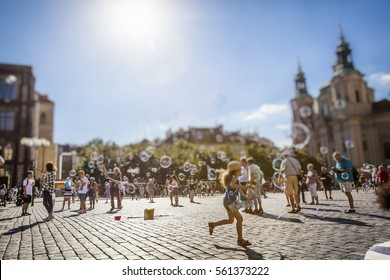 happy summer day and  children playing   on old town square in prague