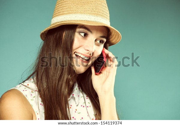 Happy summer girl teenager woman talking on mobile phone blue background