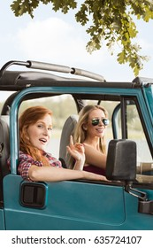 Happy summer girls driving car during sunny day