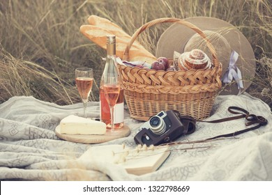 happy summer - Provencal picnic in the meadow.  baguette, wine, glasses, grapes, Cheese brie, baguette in a basket