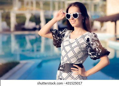 Happy Summer Woman With Sunglasses by the Pool - Portrait of a beautiful girl sunbathing